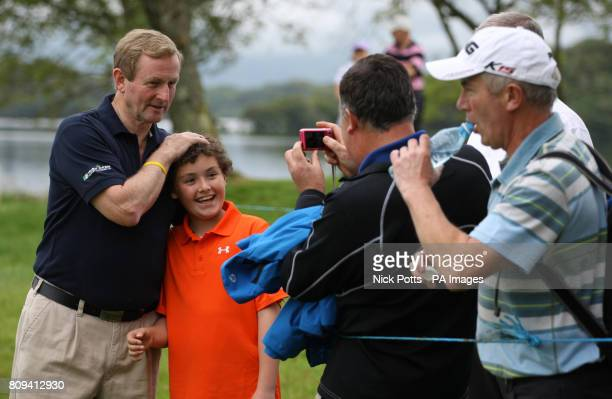Irish Taoiseach Enda Kenny has his photograph taken by the family of Edmond Healy aged 9 from Listowel County Kerry during day one of the Irish Open...