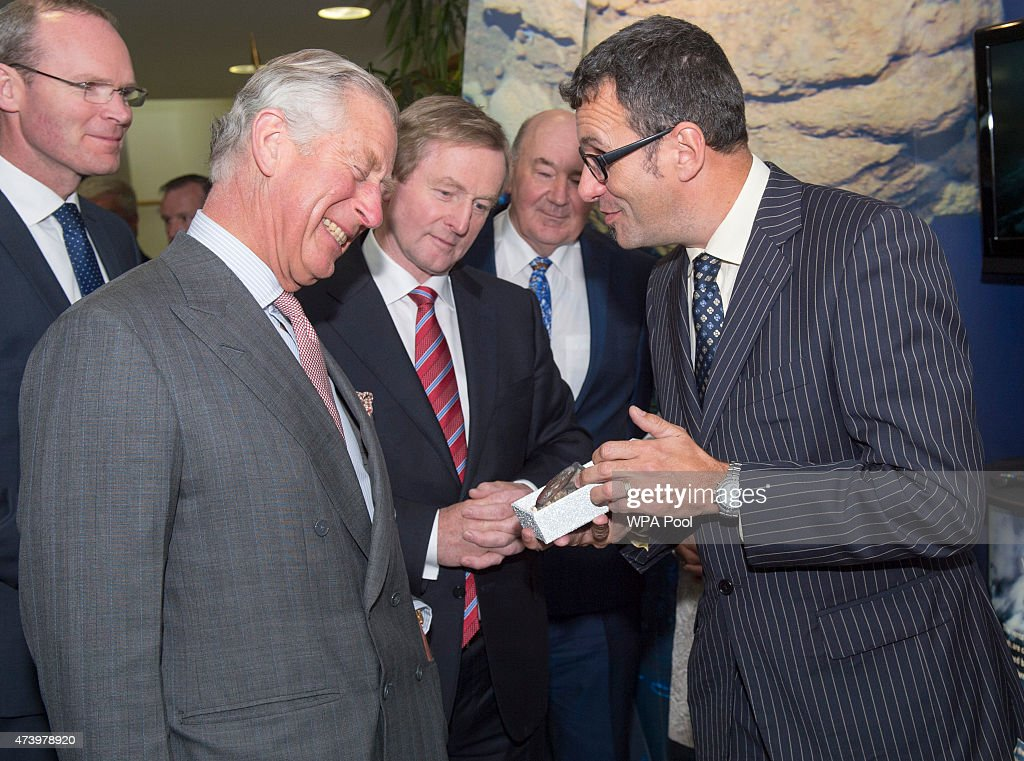 Irish Taoiseach Enda Kenny looks on as a 330 million year old fossil from near Mullaghmore was presented to Prince Charles, Prince Of Wales by Professor Andy Wheeler as the Prince visits the Marine Institute on May 19, 2015 in Galway, Ireland. The Prince of Wales and Duchess of Cornwall arrived in Ireland today for their four day visit to the Republic and Northern Ireland, the visit has been described by the British Embassy as another important step in promoting peace and reconciliation.