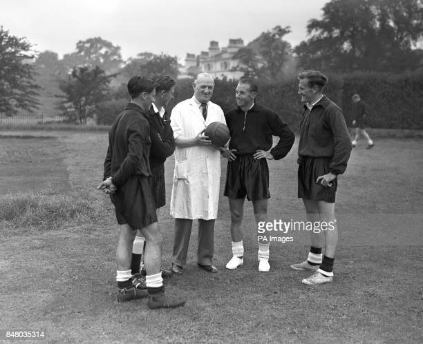 Irish trainer Gerry Morgan inspects a football watched by footballers Jimmy McIlroy Danny Blanchflower Stanley Matthews and Don Revie The Great...