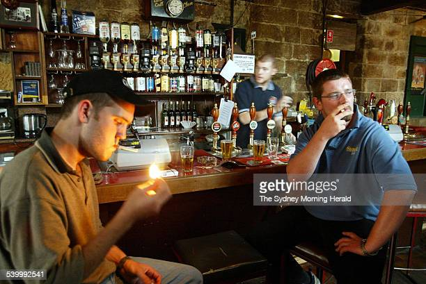 Irish visitors John Maher and Colum Creedon enjoy a beer and a smoke at the bar of the Hero of Waterloo Hotel prior to the new law that will ban...
