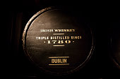 Old wooden barrel full of Dublin's Irish whiskey.