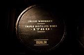 Old wooden barrel full of Dublin's Irish whiskey.
