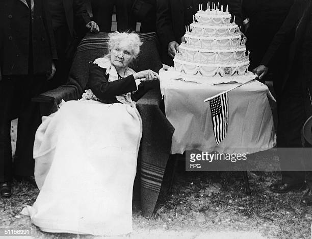 Irishborn American labor organizer Mother Jones poses with a fivetiered cake in celebration of her 100th birthday May 1 1930