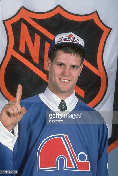 Irishborn Canadian ice hockey player Owen Nolan poses in the jersey of the Quebec Nordiques following his first round first place selection in the...