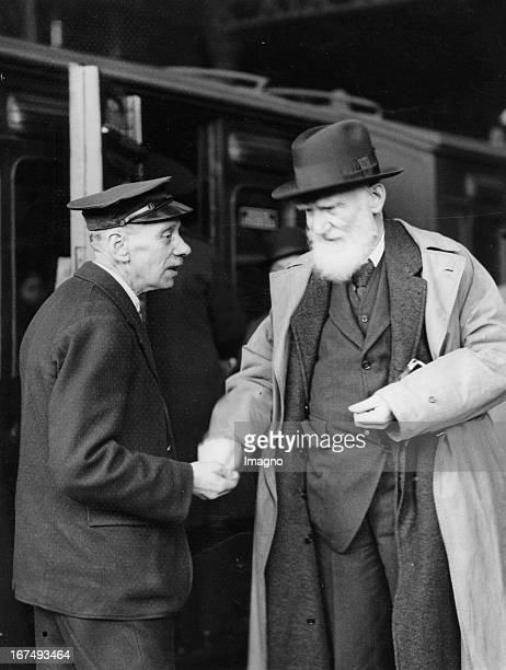 IrishBritish playwright George Bernard Shaw with a porter at the Liverpool Street Station / London on his departure to New Zealand 8th February 1934...