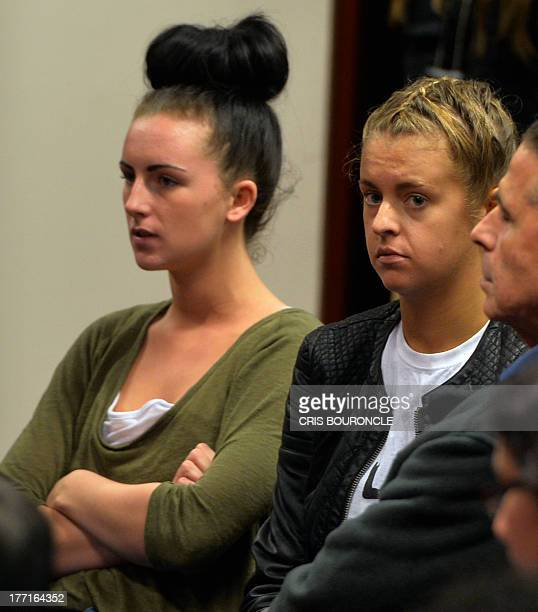 Irishwoman Michaella McCollum and Briton Melissa Reid arrested at Lima's airport for carrying cocaine in their luggage sit in a courtroom while...