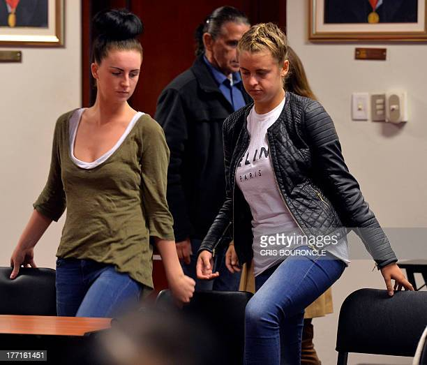 Irishwoman Michaella McCollum and Briton Melissa Reid who were arrested at Lima's airport carrying cocaine in their luggage are seen after a short...