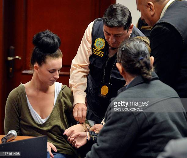 Irishwoman Michaella McCollum and Briton Melissa Reid who were arrested at Lima's airport carrying cocaine in their luggage are handcuffed before...