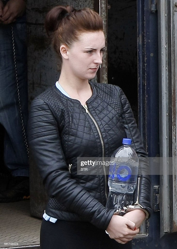 Irishwoman Michaella McCollum and companion Briton Melissa Reid (not framed) disembark handcuffed from a truck in front of the Sarita Colonia Jailhouse Court in the port of Callao, west of Lima, on September 24, 2013, to appear in court on drug trafficking charges. Both women age 20 face between 15 and 18 years in jail for their alleged attempt to sneak a total of 11 kilos (24 pounds) of cocaine on a flight to Spain early August, and Reid has already indicated an intention to plead guilty in exchange for a shorter sentence, while the UK Foreign Office has confirmed there is a prisoner transfer agreement between the UK and Peru.