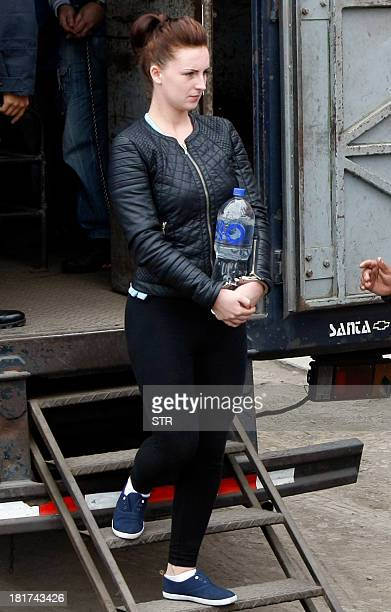 Irishwoman Michaella McCollum and companion Briton Melissa Reid disembark handcuffed from a truck in front of the Sarita Colonia Jailhouse Court in...