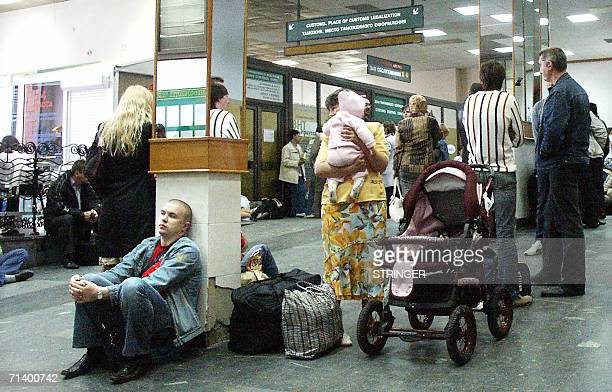 Passengers wait for their delayed flights in the departure hall of Irkutsk airport 09 July 2006 At least 140 people died when a Russian Airbus plane...