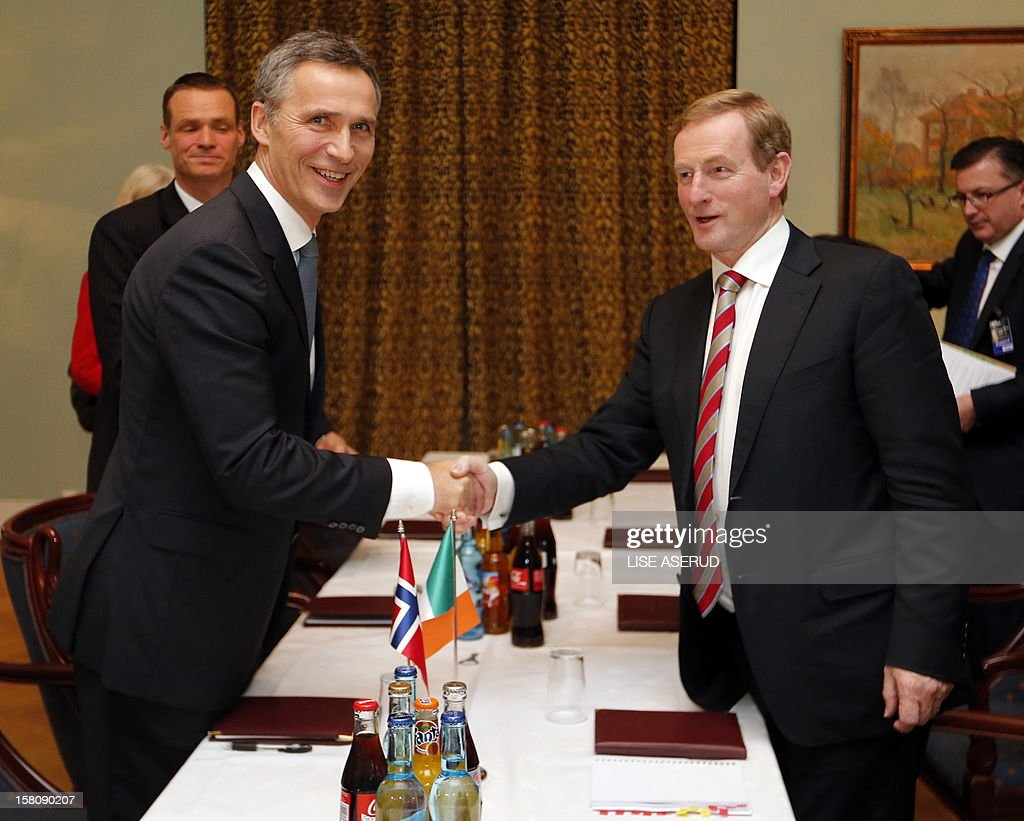 Irland's Prime Minister Enda Kenny (R) shakes hands with his Norwegian counterpart Jens Stoltenberg in Oslo after the Nobel Peace Prize ceremony on December 10, 2012. The EU collects this year's prestigious Nobel Peace Prize, with the bloc battered and divided by a three-year economic crisis threatening the continent's social stability. AFP PHOTO / LISE ASERUD /SCANPIX NORWAY /NORWAY OUT