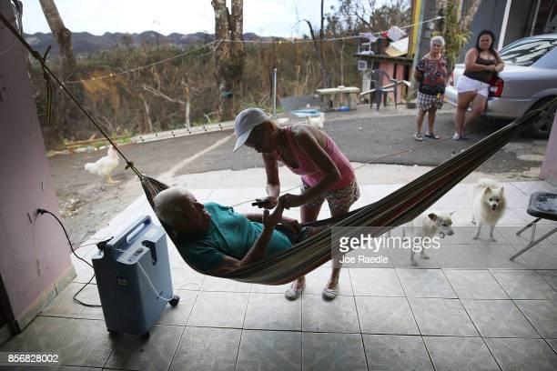 Irma Maldanado checks on her father Ignacio Maldanado Ortiz who uses an oxygen machine due to his emphysema on October 2 2017 in Corozal Puerto Rico...