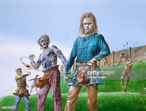 Iron Age tribesmen c5th century BC Reconstruction drawing of Iron Age tribesmen armed with slings at Maiden Castle was an Iron Age hill fort in the...