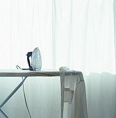 Iron and shirt on ironing board