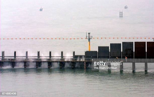 Iron boards to separate the sea are dropped for Isahaya Bay reclamation on April 14 1997 in Isahaya Nagasaki Japan
