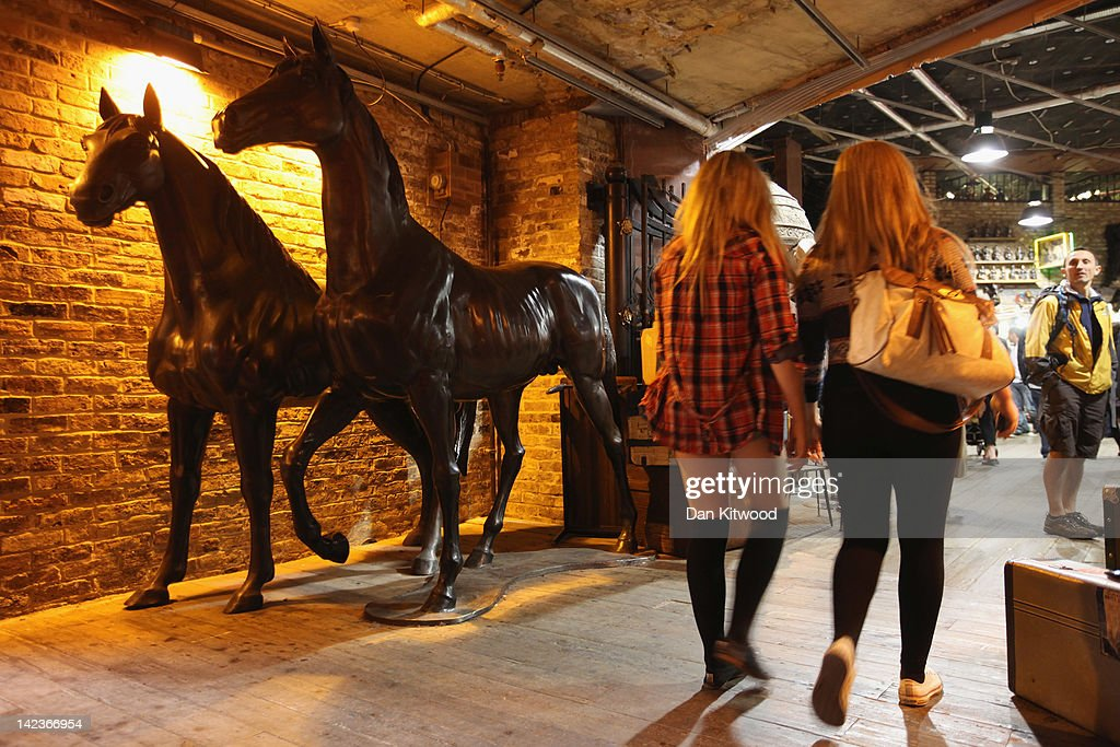 Iron casts of horses mark the entrace to Horse Tunnel in Camden Market on March 31, 2012 in London, England. Camden in North London has been one of the city's cultural centres since the 1960's, and is home to the famous Camden Market. The borough is rich in musical heritage with a variety of musical and comedy venues, theatres and art galleries.