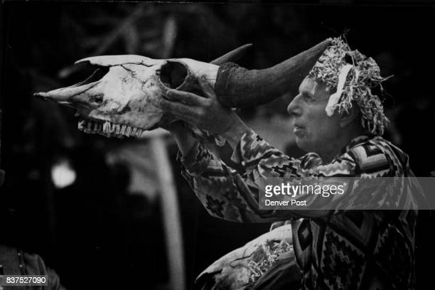 Iron Eyes Cody holds a buffalo skull aloft while the dancers were leaving the area The dancers fasted four days before the ceremony Credit Denver Post