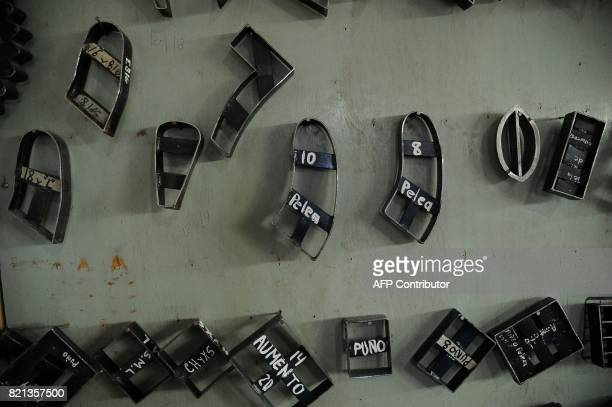 Iron molds used to produce different shapes and sizes of boxing gloves are seen at Reyes Industries headquarters in Mexico city on July 06 2017 Cleto...
