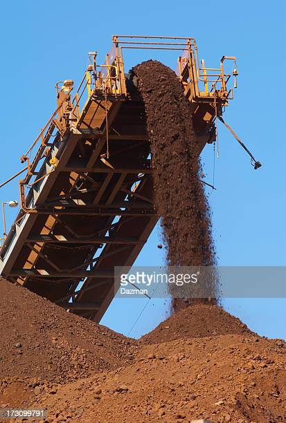 Iron ore being loaded onto a stockpile.