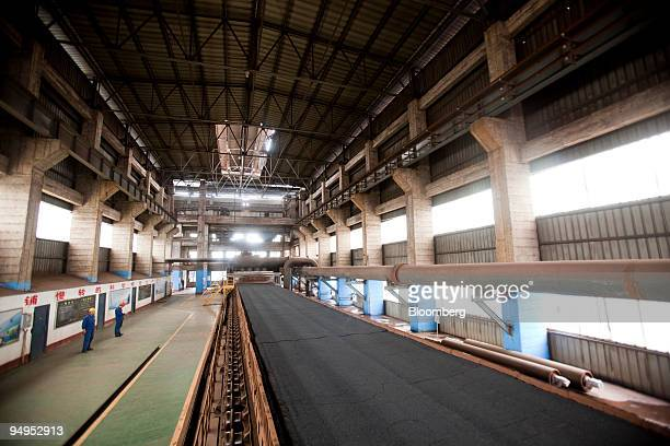 Iron ore moves through the production process at the China Oriental Group Co steel plant in Tangshan Hebei province China on Saturday Aug 29 2009...