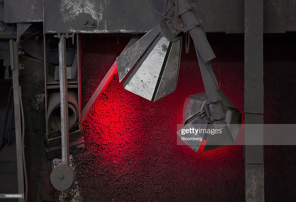 Iron ore pellets pass through a machine during manufacture at the Lebedinsky GOK (LGOK) iron ore mining and processing plant, operated by Metalloinvest Holding Co., in Gubkin, Russia, on Tuesday, May 28, 2013. Lebedinsky, Russia's third biggest iron ore mine, is owned 81 percent owned by Russian billionaire Alisher Usmanov, who also owns Mikhailovsky GOK, Russia's second-biggest iron ore mine, and Oskol Electrometallurgical Combine, a steel plant supplied by Lebedinsky. Photographer: Andrey Rudakov/Bloomberg via Getty Images