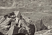 Iron ore opencast mining: close up view - black and white image