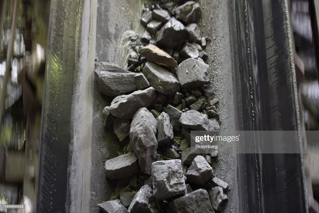 Iron ore rock moves along a conveyor belt during processing at the Lebedinsky GOK (LGOK) iron ore plant, operated by Metalloinvest Holding Co., in Gubkin, Russia, on Tuesday, May 28, 2013. Lebedinsky, Russia's third biggest iron ore mine, is owned 81 percent owned by Russian billionaire Alisher Usmanov, who also owns Mikhailovsky GOK, Russia's second-biggest iron ore mine, and Oskol Electrometallurgical Combine, a steel plant supplied by Lebedinsky. Photographer: Andrey Rudakov/Bloomberg via Getty Images