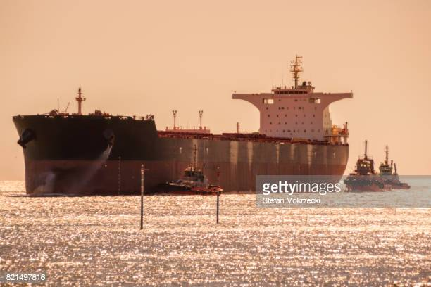 Iron Ore Ship And Tugboats Arriving, Port Hedland, Western Australia, Australia