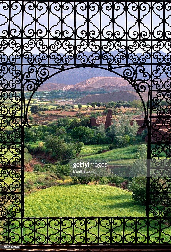 Iron Rod Window Overlooking Moroccan Countryside