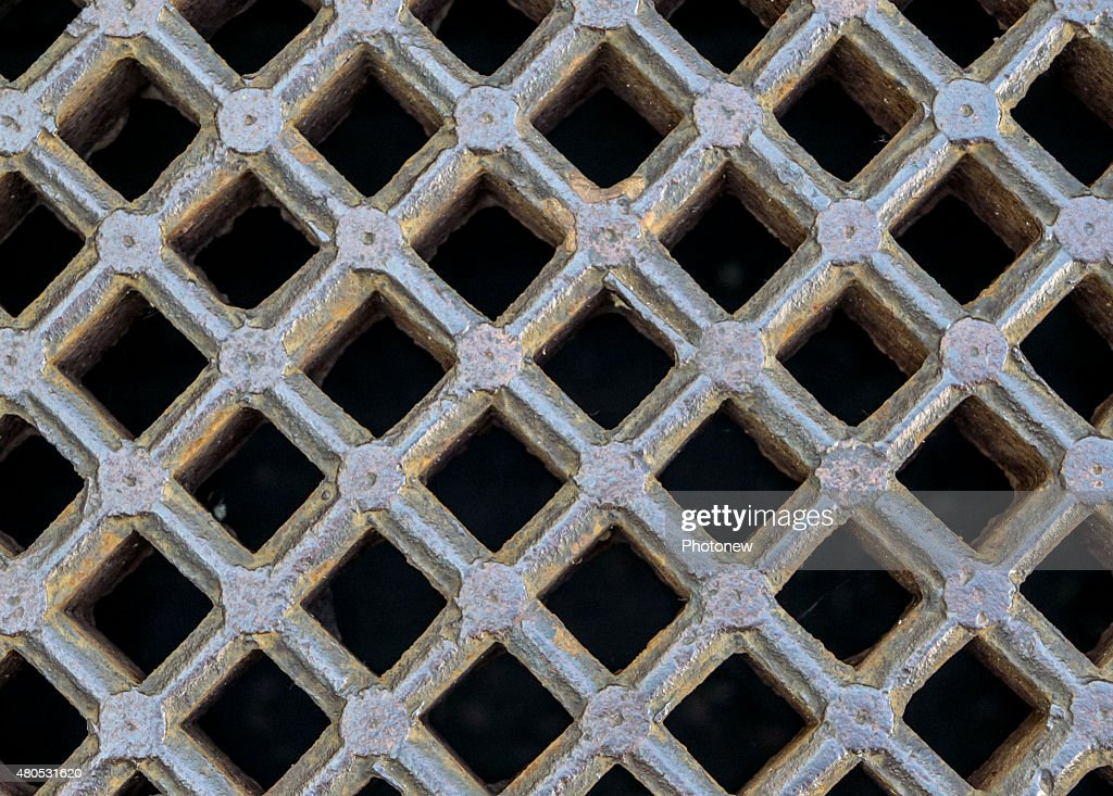 iron sewer grate background : Stock Photo