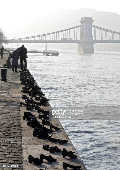 Iron shoes are pictured on the bank of the Danube on January 27 marking the Holocaust in Hungary Hundreds of Hungarian Jews had to leave their shoes...