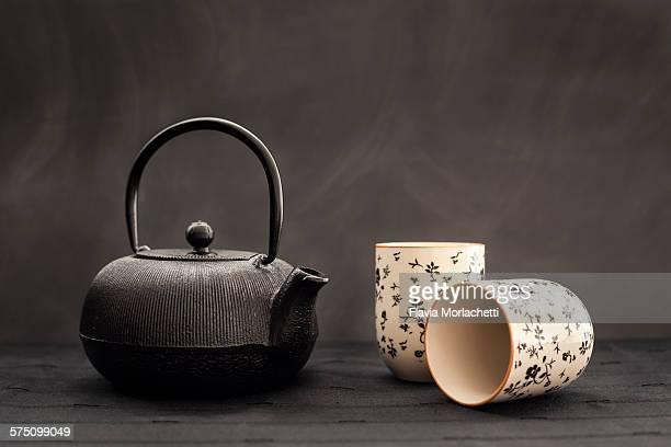 Iron teapot and asian teacups