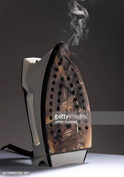 Iron with bottom burnt, studio shot