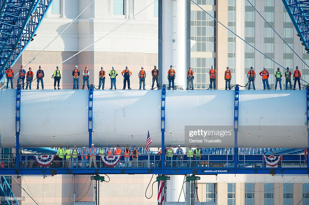Iron workers employed by American Bridge (Top Row L-R) Ugo Del Costello, Robert Conway, James McCullough, Stuart Shew, Shawn McClelland, Cory Zobrist, Thomas Pype, Slade Boyd, Robert Fitz, Robert Horton, Ryan Sloan, Seth Wilson, Curns Moore, Michael Scales, Trevor Burgess, Joseph Landis, Chaz Woods, J.J. Trujillo, Joshua Horn, Bruce Barkovich and George McManus (Bottom Row L- R ) Jason Faltinowski, Jason Broderdorf, Austin White, Rob McDonald, Lance Pierce, Dan Radu, Lou Wehar, Mike Cegelis, Jeremiah Beiter, John Callaghan, Dan Schwarz, Tim Popham, Simon Laming and James Dipasquale stand across the hub and spindle of Caesars Entertainment's High Roller, a 550-foot tall observation wheel taking shape on the Las Vegas Strip and redefining the iconic Las Vegas skyline. The largest observation wheel in the world, the High Roller will be the focal point of The LINQ, a $500 million open-air retail, dining and entertainment district on August 30, 2013 in Las Vegas, Nevada.