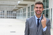 Ironic businessman showing a middle finger.