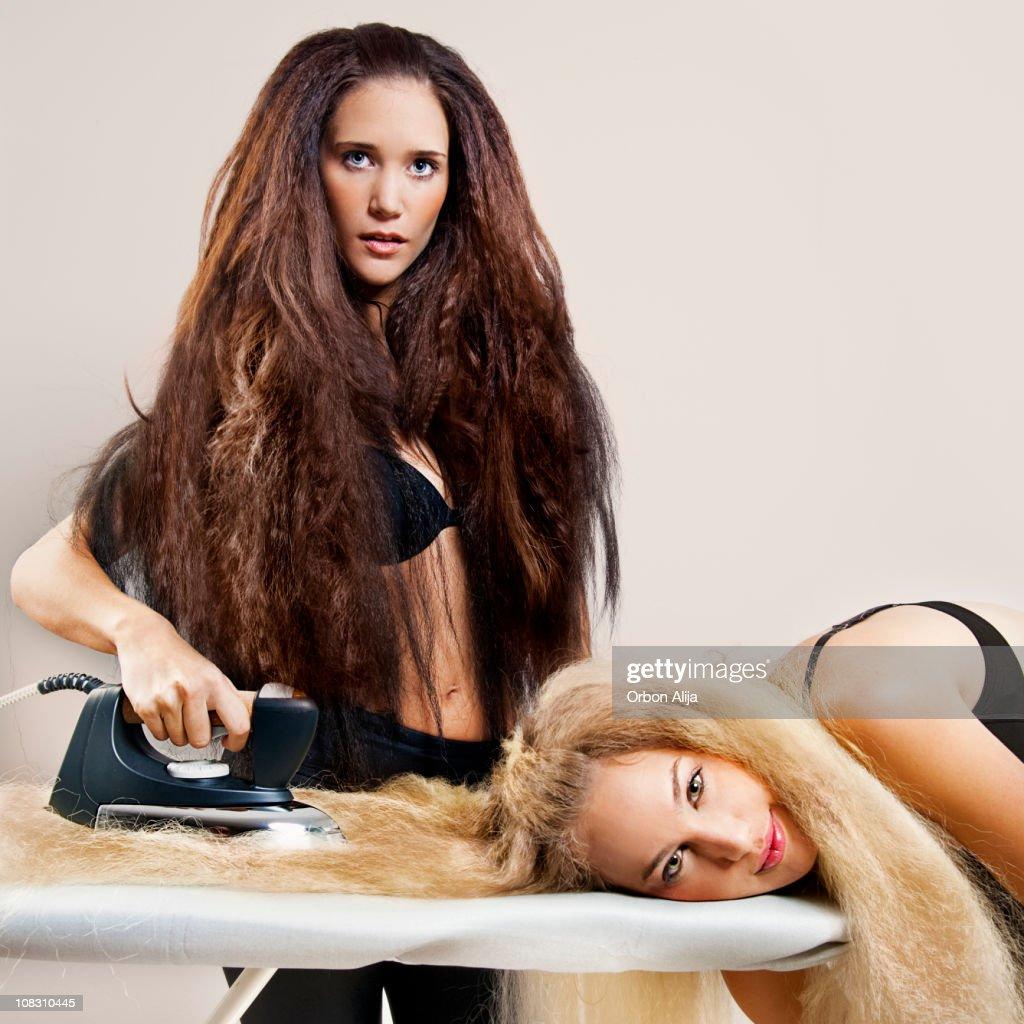 Ironing frizzy hair : Stock Photo