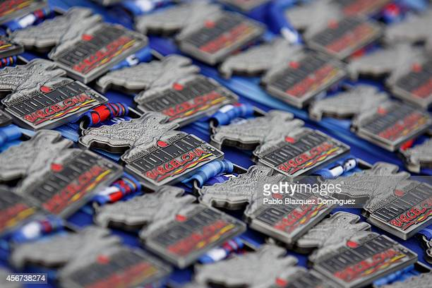Ironman Finisher medals lay on a table at the finish line of Ironman Barcelona on October 5 2014 in Calella city near Barcelona Spain