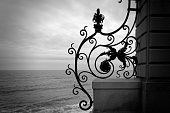 Ironwork fence by the ocean.
