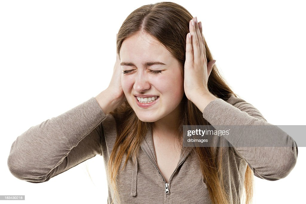 Irritated Young Woman Covers Ears