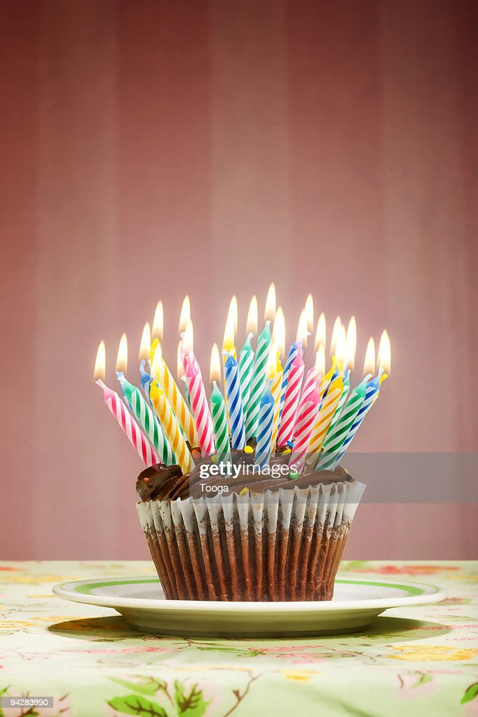 irthday cupcake overloaded with candles : Stock Photo