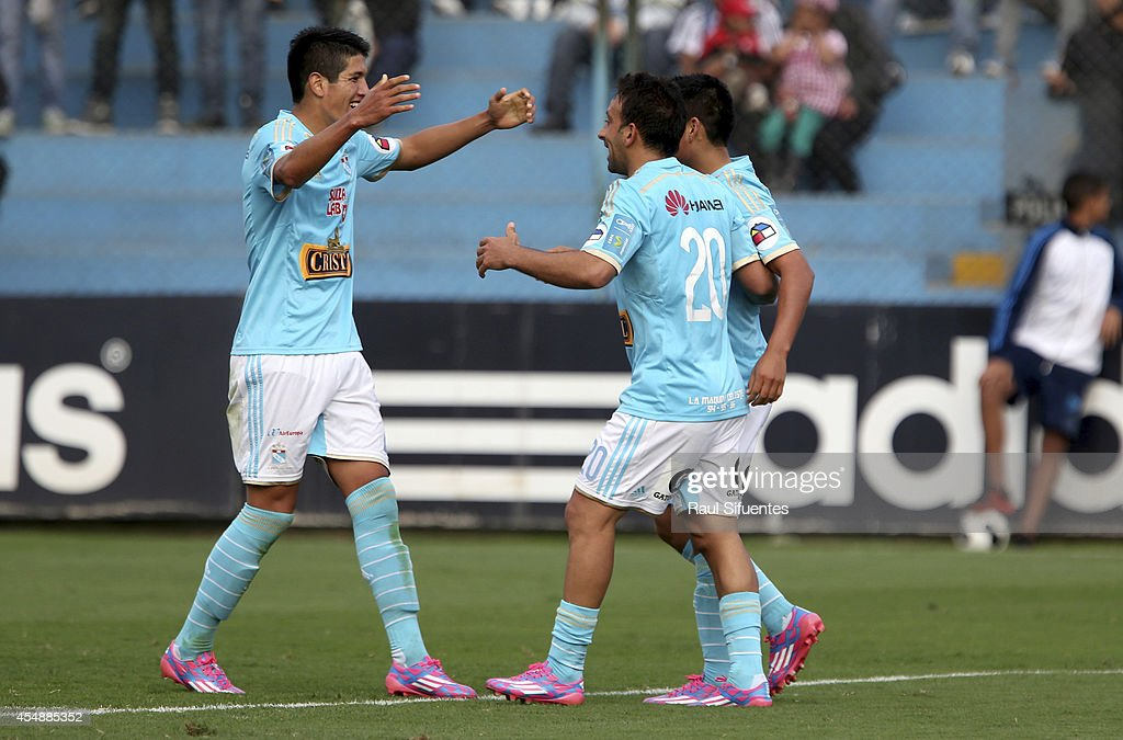 Irven Avila of Sporting Cristal celebrates a scored goal against UTC during a match between Sporting Cristal and UTC as part of first round of Torneo Clausura 2014 at Alberto Gallardo Stadium on September 07, 2014 in Lima, Peru.