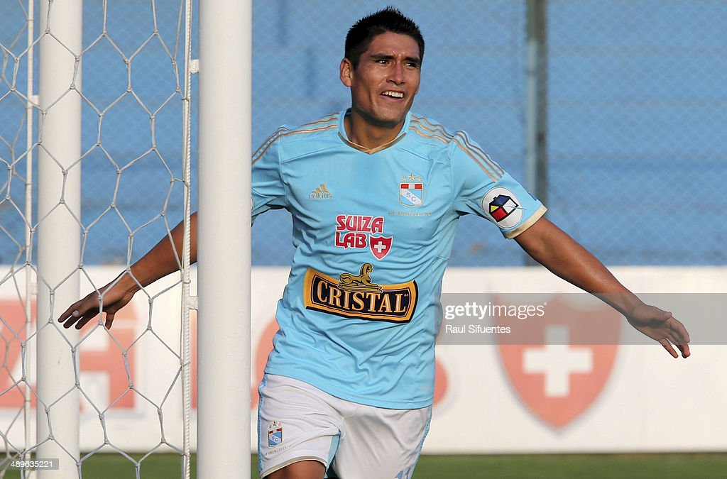 Irven Avila of Sporting Cristal celebrates after scoring the opening goal during a match between Sporting Cristal and Juan Aurich as part of 13th round of Copa Inca 2014 at Alberto Gallardo Stadium on May 11, 2014 in Lima, Peru.