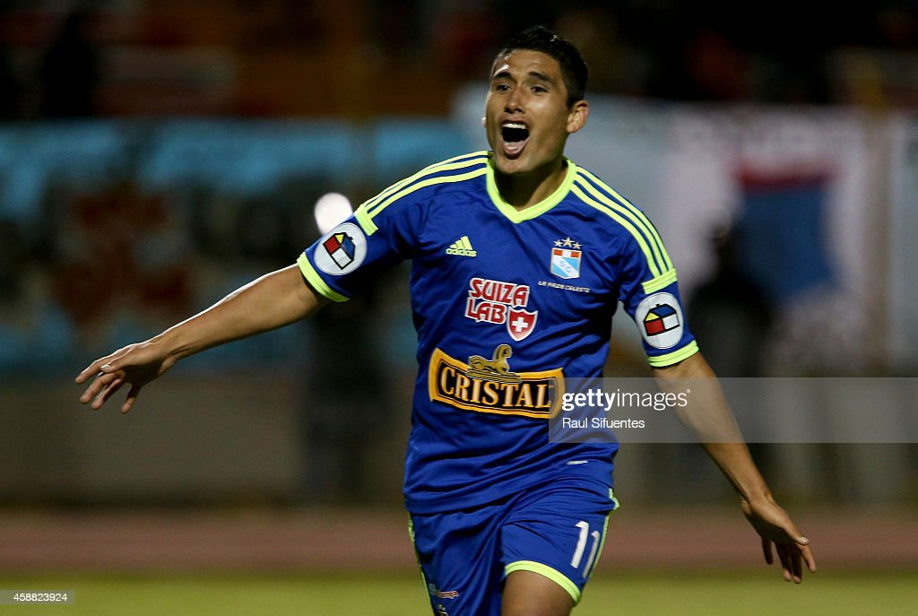 Irven Avila of Sporting Cristal celebrates the first goal of his team against Sport Huancayo during a match between Sport Huancayo and Sporting Cristal as part of round eleven of Torneo Clausura 2014 at Huancayo Stadium on November 11, 2014 in Huancayo, Peru.
