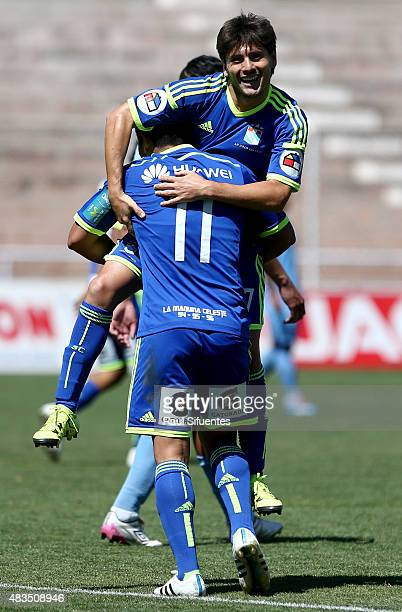 Irven Avila of Sporting Cristal celebrates with his teammate after scoring the fourth goal of his team during a match between Real Garcilaso and...