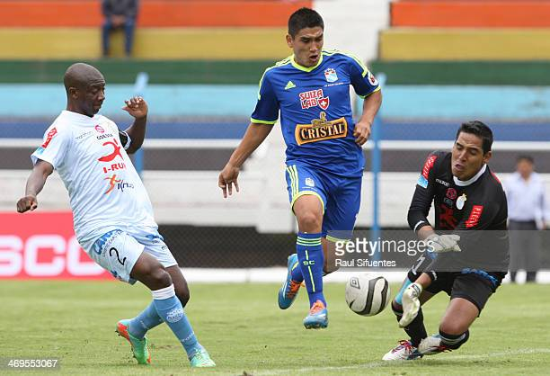 Irven Avila of Sporting Cristal struggles for the ball with Juan Pretell of Real Garcilaso during a match between Real Garcilaso and Sporting Cristal...