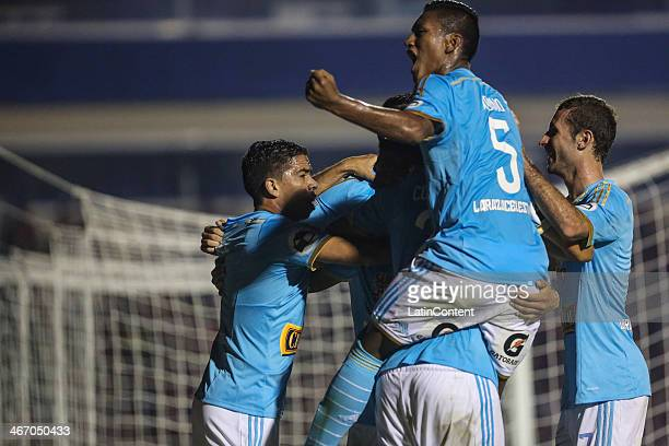 Irven Ávila of Sporting Cristal celebrates a scored goal with teammates during a match between Atletico Paranaense v Sporting Cristal as part of the...