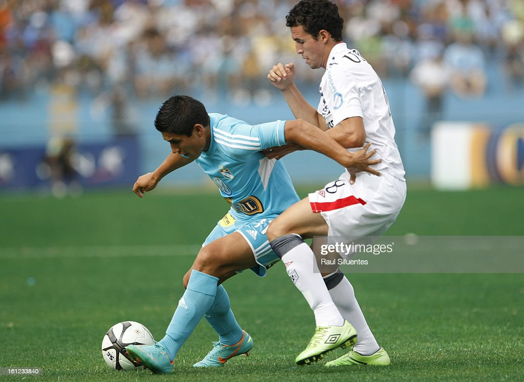 Irvin Avila of Sporting Cristal fights for the ball with Claudio Torrejon of San Martin during a match between Sporting Cristal and San Martin as part of The 2013 Torneo Descentralizado at the Alberto Gallardo Stadium on February 09, 2013 in Lima, Peru