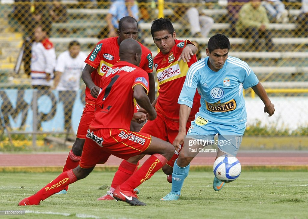 Irvin Avila of Sporting Cristal fights for the ball with Rafael Farfan of Sport Huancayo during a match between Sport Huancayo and Sporting Cristal as part of The Torneo Descentralizado 2013 at the Huancayo Stadium on February 18, 2013 in Huancayo, Peru