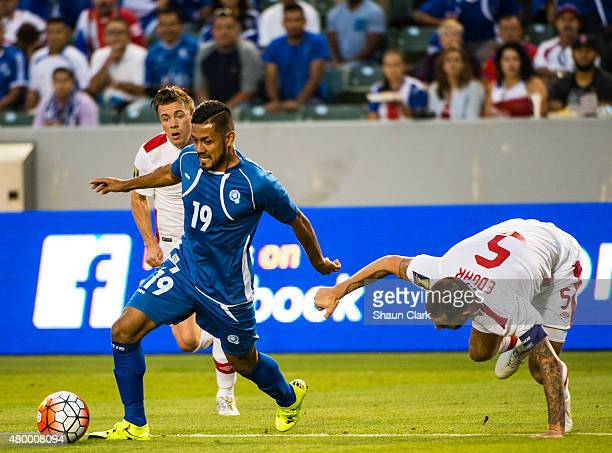 Irvin Herrera of El Salvador goes past David Edgar of Canada during the 2015 CONCACAF Gold Cup Group B match between El Salvador and Canada at the...